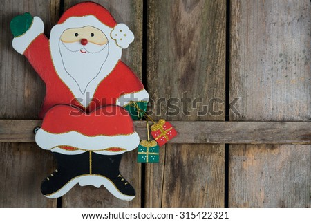 Santa Claus on a wooden board