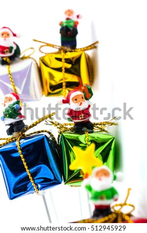 santa claus on gift box on white background