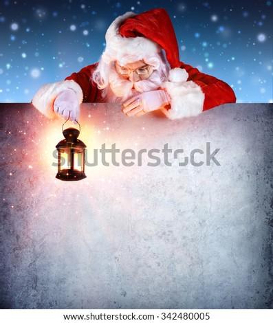 Santa Claus On Vintage Billboard With Lantern  - stock photo