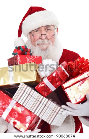 Santa Claus or Father Christmas holding a large pile of presents, isolated on white background. - stock photo