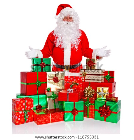 Santa Claus or Father Christmas standing with a large collection of gift wrapped presents, isolated on a white background. - stock photo