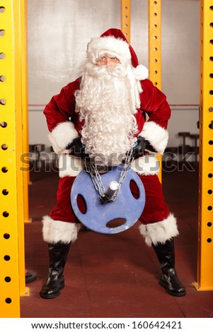 Santa Claus physical condition training before Christmas time in gym - stock photo