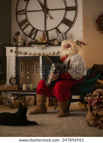 Santa Claus Playing Acordeon at Home