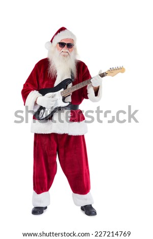 Santa Claus plays guitar with sunglasses on white background - stock photo