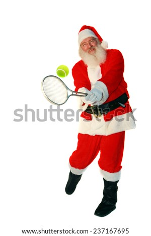 Santa Claus Plays Tennis. Focus on the Tennis Racket and Ball with Santa slightly out of focus. Isolated on white with room for your text. Santa Loves Sports and plays tennis with the elves daily. - stock photo