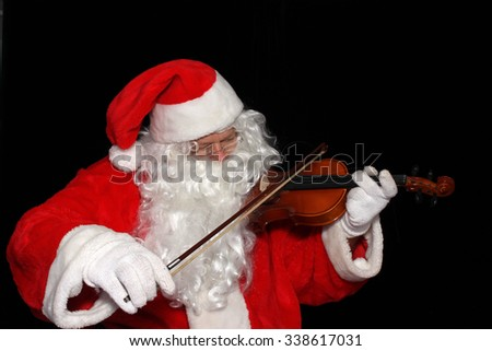 Santa Claus plays the Violin  - stock photo