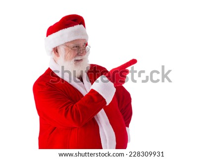 Santa Claus pointing at something and laughing - stock photo