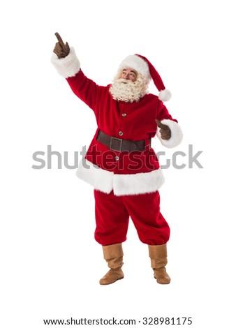 Santa Claus pointing his finger away Full-Length Portrait - stock photo