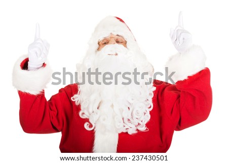 Santa Claus pointing his hands up. - stock photo