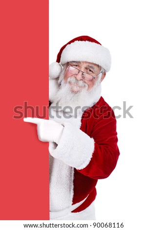 Santa Claus pointing in blank red banner, isolated on white background - stock photo
