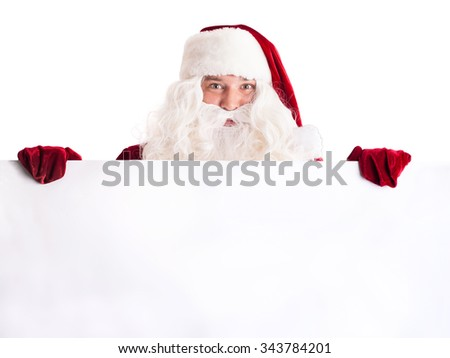 Santa Claus pointing in white blank sign isolated on white background