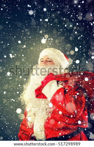 Santa Claus. Portrait of Santa Claus. Santa Claus carries a bag with gifts. Christmas Fantasy.