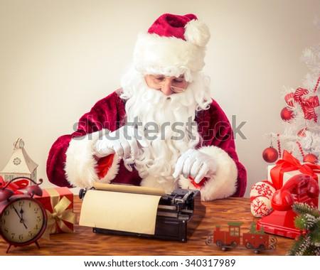Santa Claus pound manual typewriter. Christmas holiday concept - stock photo