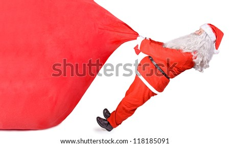 santa claus pulling a big bag on white background - stock photo