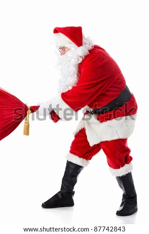Santa Claus pulls a bag on a white background - stock photo
