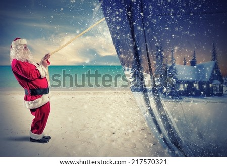 Santa Claus pulls the winter  to make change to summer - stock photo