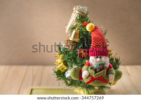 Santa Claus puppet on Christmas tree, Santa Claus against a Christmas tree:still life - stock photo