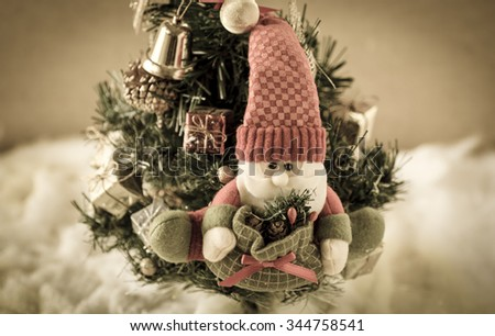 Santa Claus puppet on Christmas tree, Santa Claus against a Christmas tree:vintage style - stock photo