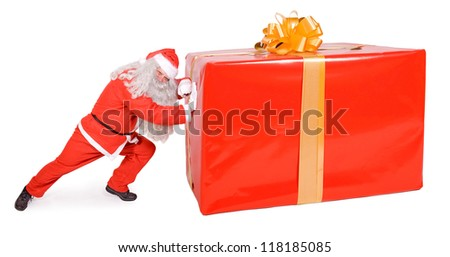 Santa Claus pushes a large package isolated on a white background. Santa Claus pushing a big Christmas gift box. Giant Xmas surprise of present. - stock photo