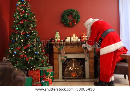 Santa Claus putting Christmas gifts in stockings