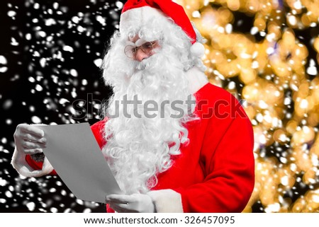 Santa Claus reading a letter  - stock photo