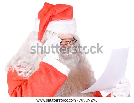 Santa Claus reads the letter on white background