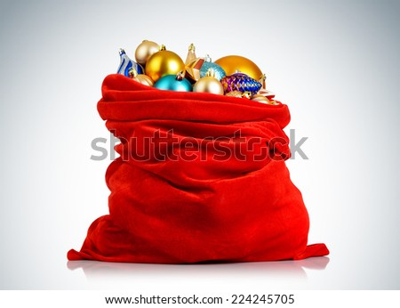 Santa Claus red bag with Christmas toys on background. File contains a path to isolation.
