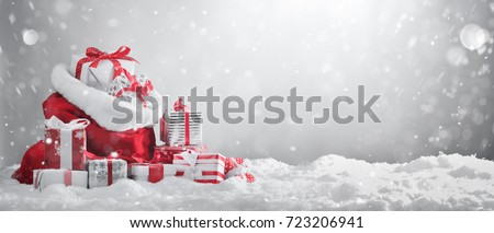 Santa Claus red bag with gift boxes.