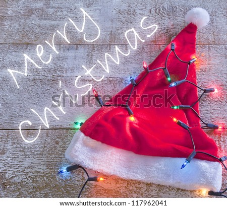 santa claus red hat and christmas lights - stock photo