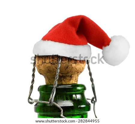 Santa Claus red hat in Champagne Bottle isolated on white - stock photo