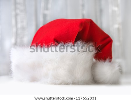 Santa Claus red hat on light background - stock photo