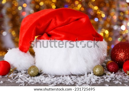 Santa Claus red hat on lights background