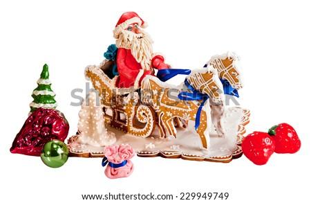 Santa Claus rides on horseback.Festive cake.Merry Christmas.Happy New Year! Image on white background. - stock photo