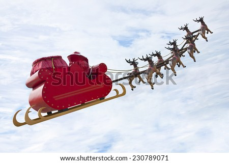Santa Claus riding a sleigh in a day light led by reindeers - stock photo