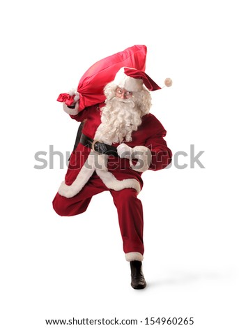 Santa Claus runs with big red sack - stock photo