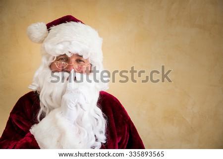Santa Claus secret. Christmas holiday concept - stock photo