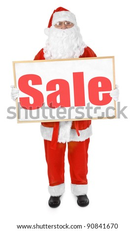 Santa claus showing bulletin board with Sale inscription - stock photo