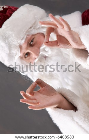 Santa Claus showing symbol OK
