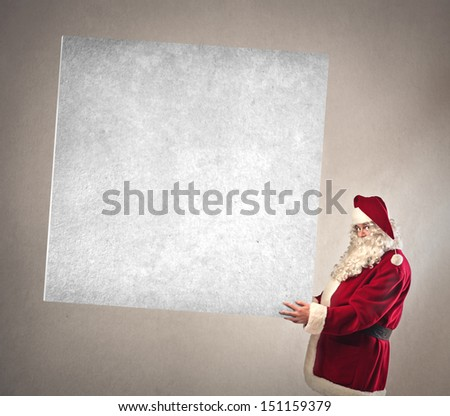 Santa Claus shows billboard - stock photo