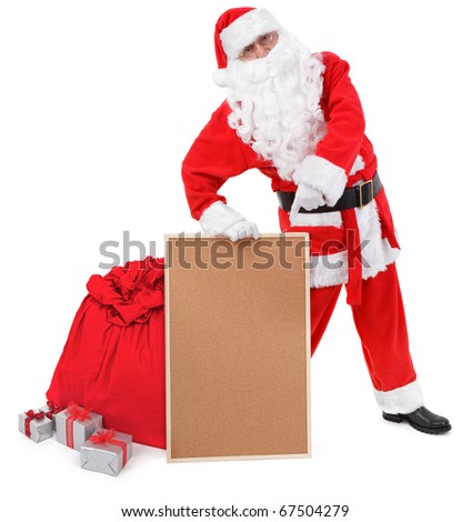 Santa claus shows empty bulletin board on white, minimal natural shadow in front - stock photo