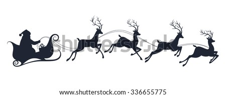 Santa Claus silhouette riding a sleigh with deers - stock photo