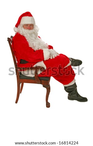 Santa Claus sits in his chair and waits for you to tell him what you want for christmas  isolated on white - stock photo