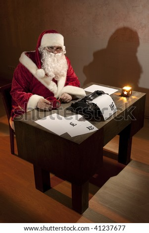 Santa Claus sitting by a desk
