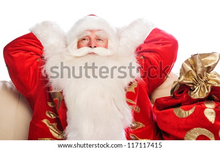 Santa Claus sitting with a sack indoor relaxing isolated