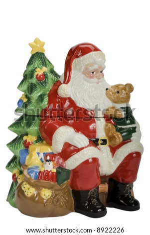Santa Claus sitting with a teddy bear on his lap in front of a christmas tree. cookie jar - stock photo