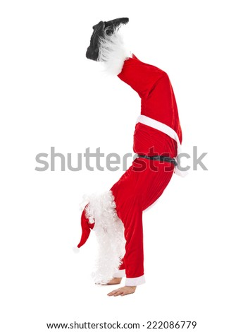 Santa Claus standing head over feet isolated on white background