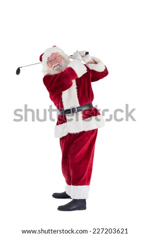 Santa Claus swings his golf club on white background - stock photo