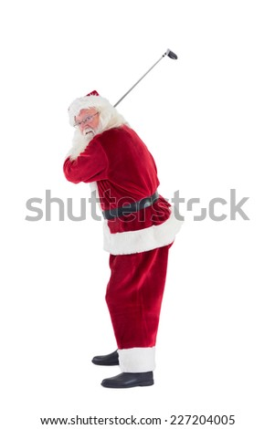 Santa Claus swings his golf club on white background - stock photo