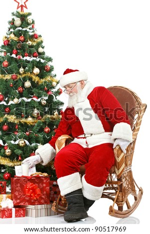 Santa Claus takes a milk and cookie left out for him, Santa snack, isolated on white background - stock photo