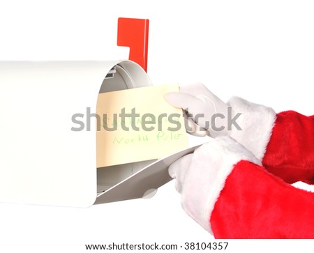 Santa Claus taking a letter from his mailbox. Horizontal isolated on white, hands only. - stock photo